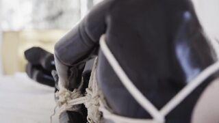 Slavery in a latex ebony catsuit