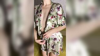 Hotty in gown shows her charms and jerks off on camera
